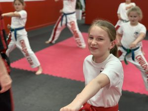 A Confident child tackling bullying by practicing martial arts