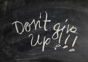 Chalk board saying don't give up